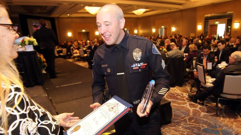 Glendale Police Sergeant Teal Metts is awarded Chief's Award of Excellence during the 24th Annual Gl