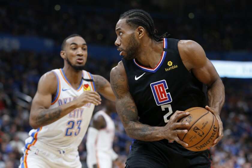 Kawhi Leonard looks for an opening against the Thunder's Terrance Ferguson during the first half of a game March 3 at Chesapeake Energy Arena.