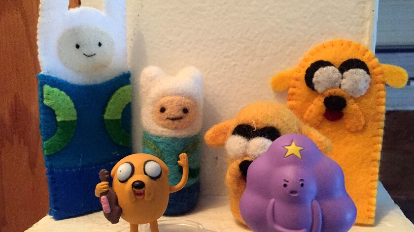 """""""Adventure Time"""" figures, official product and folk art, in the author's collection."""