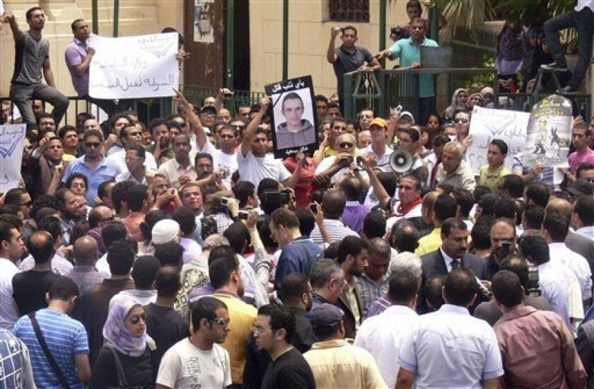 Egyptians shout anti-police slogans during a demonstration in Alexandria, Egypt Saturday June 12, 2010, after the police beat a young businessman to death on an Alexandria street after he posted a video on the Internet of officers sharing the spoils from a drug bust among themselves, his family sa