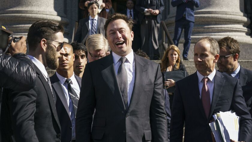 Tesla CEO Elon Musk exits federal court in New York on April 4.