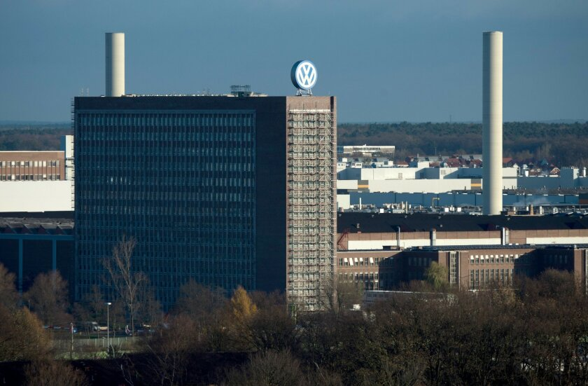 View of the Volkswagen factory in Wolfsburg, Germany, Friday Nov. 20, 2015. Volkswagen CEO Michael Mueller says the company's board has decided to reduce capital expenditures by 1 billion euros ($1.07 billion) in 2016 as it deals with the fallout of its emissions-rigging scandal. Mueller said Friday after a meeting of the board at company headquarters in Wolfsburg, German, that the cuts would bring capital expenditure down to 12 billion euros next year. (Julian Stratenschulte/dpa via AP)