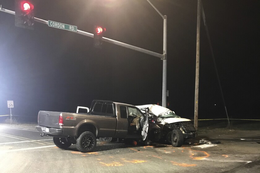This Friday, Nov. 29, 2019, photo provided by the Marion County Sheriff's Office shows the scene of a deadly motor vehicle crash in Salem, Ore. A van carrying Guatemala workers collided with a pickup truck at an Oregon intersection. (Marion County Sheriff's Office via AP)