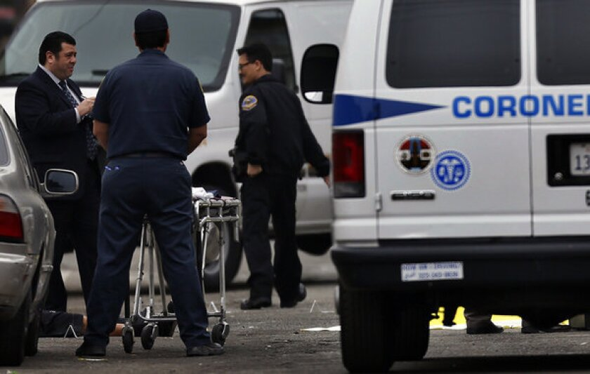 Pomona police investigators and coroner's officials at the scene of a shooting in Pomona in April. The city has seen a sharp spike in killings in 2013.