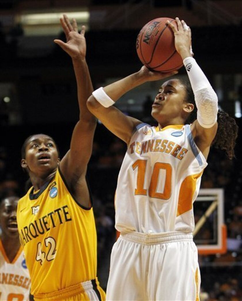 Tennessee guard Meighan Simmons (10) shoots over Marquette forward Sarina Simmons (42) during the first half of a second-round game in the NCAA college basketball tournament on Monday, March 21, 2011, in Knoxville, Tenn. (AP Photo/Mark Humphrey)