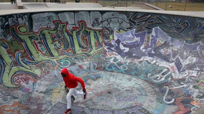 Los Angeles, CA-MAY 5, 2019: Khordae Phillips, 14, skates in a graffiti-drenched bowl that attracts