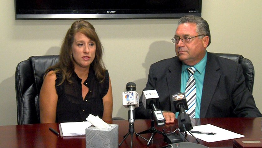 Former teacher Carie Charlesworth with her lawyer Kenneth Hoyt in September discussing her lawsuit against the Roman Catholic Diocese of San Diego.