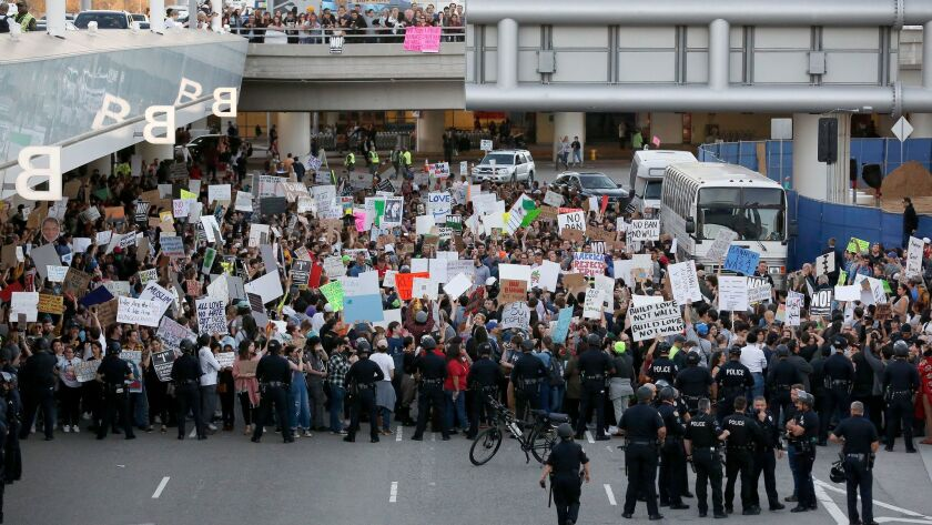Police officers block demonstrators from marching on the lower roadway during a protest against President Donald Trump's executive order banning travel from seven Muslim-majority countries, at Los Angeles International Airport on Jan. 29.