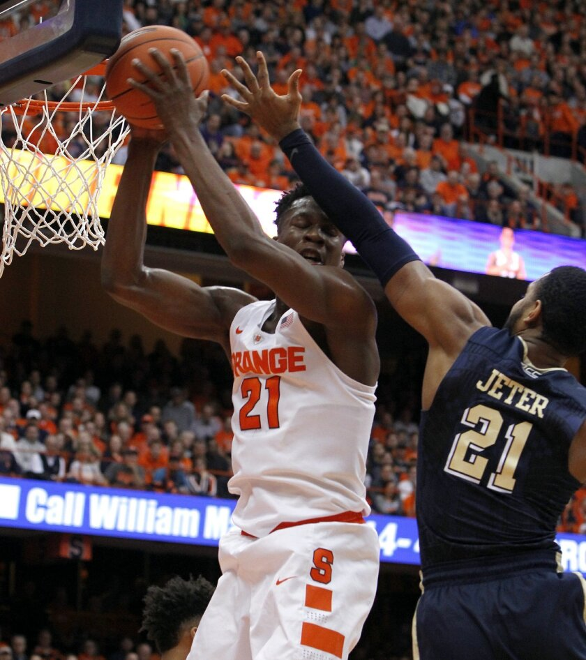 Syracuse's Tyler Roberson, left, grabs a rebound over Pittsburgh's Sheldon Jeter, right, in the first half of an NCAA college basketball game in Syracuse, N.Y., Saturday, Feb. 20, 2016. (AP Photo/Nick Lisi)