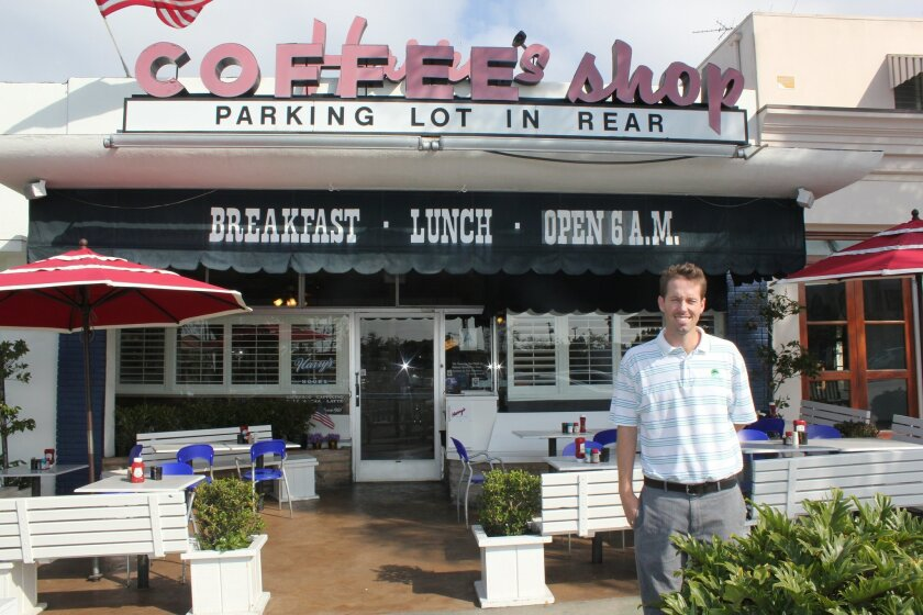 John Rudolph stands outside his family's restaurant. Photo: Dave Schwab
