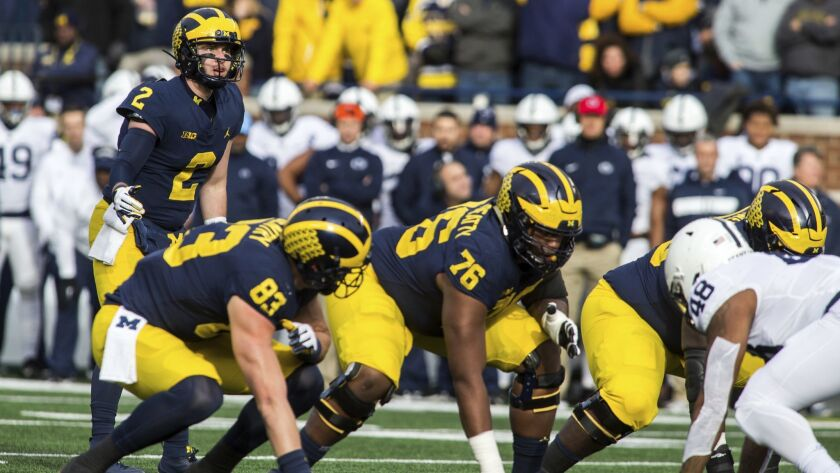 Michigan quarterback Shea Patterson (2) prepares to take a snap in the first quarter of an NCAA coll