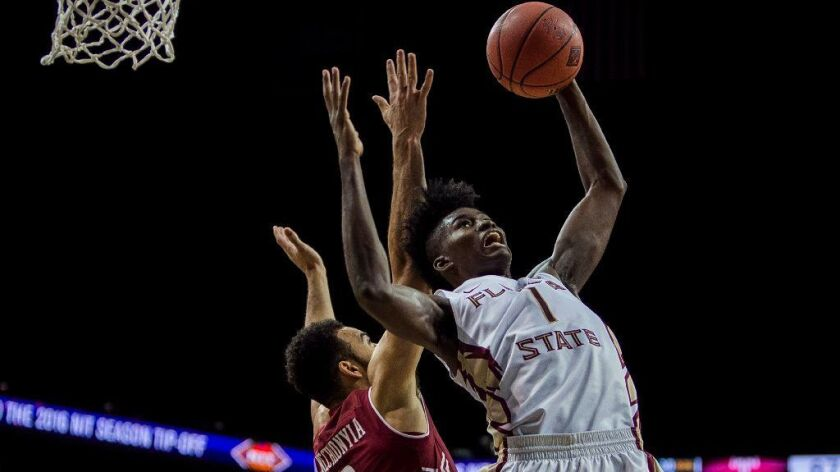 Florida State's Jonathan Isaac misses a shot against Temple during the NIT Season Tip-Off tournament