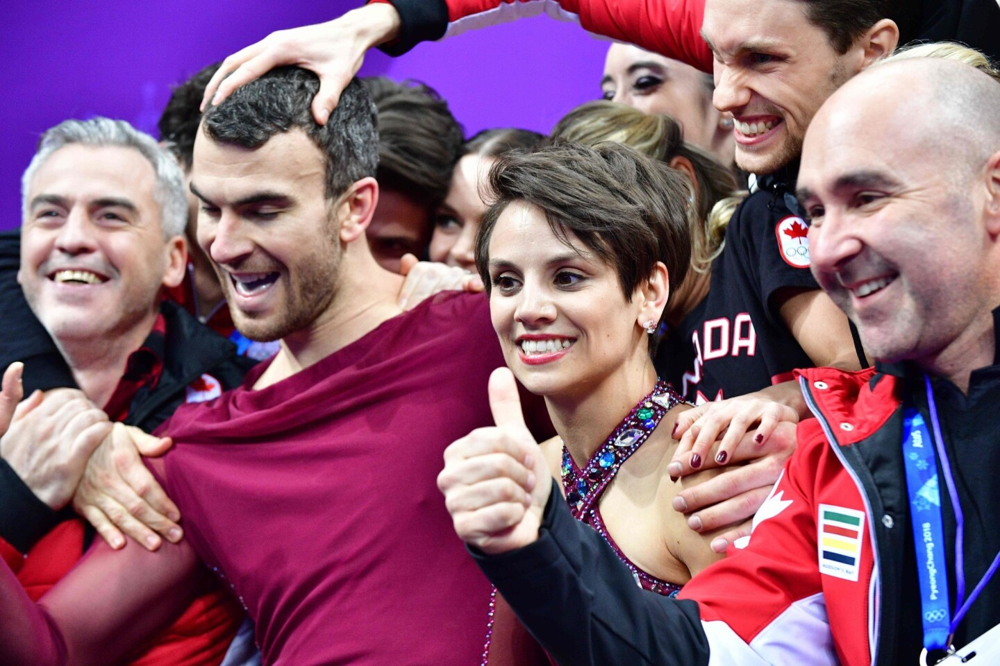 TOPSHOT - Canada's Meagan Duhamel (centre R) and Canada's Eric Radford (centre L) react after competing in the figure skating team event pair skating free skating during the Pyeongchang 2018 Winter Olympic Games at the Gangneung Ice Arena in Gangneung on February 11, 2018. / AFP PHOTO / Mladen ANTONOVMLADEN ANTONOV/AFP/Getty Images ** OUTS - ELSENT, FPG, CM - OUTS * NM, PH, VA if sourced by CT, LA or MoD **