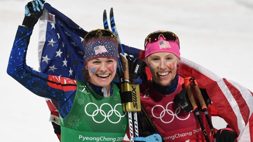 Jessica Diggins, left, and Kikkan Randall celebrate winning gold in the women's cross country team sprint free final during the Pyeongchang 2018 Winter Olympic Games on Wednesday.