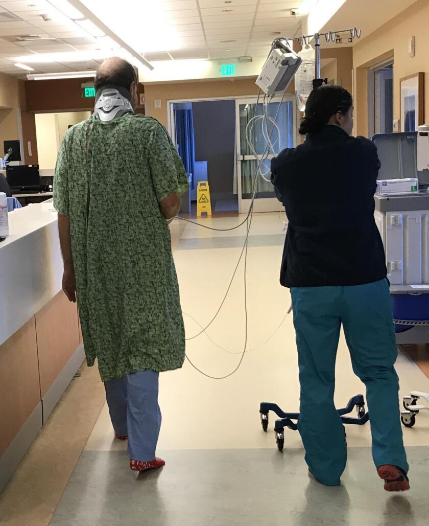 Olof, wired up, takes a jaunt around the Trauma ICU with a nurse.