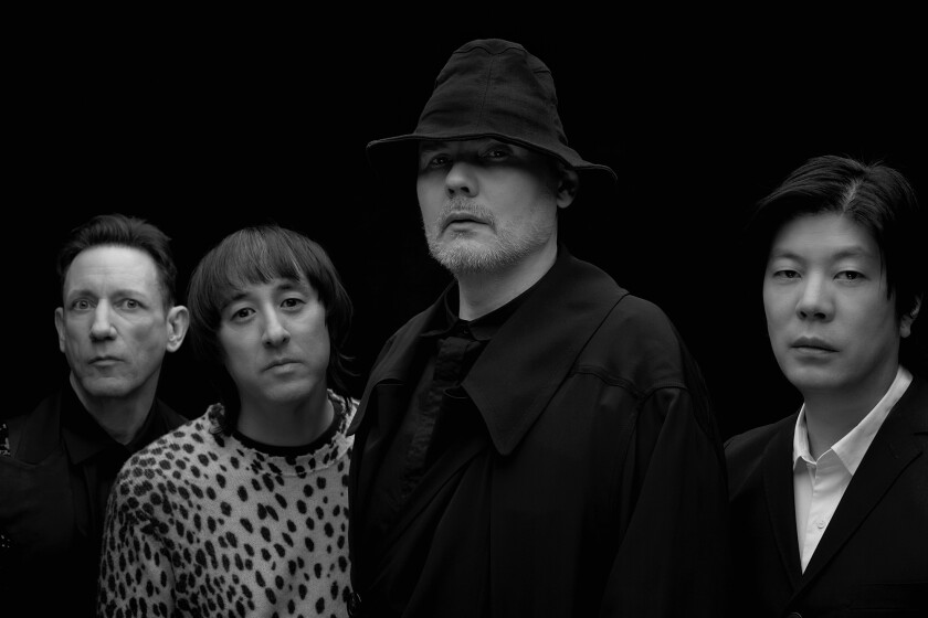 Smashing Pumpkins' Jimmy Chamberlin, from left, Jeff Schroeder, Billy Corgan and James Iha.