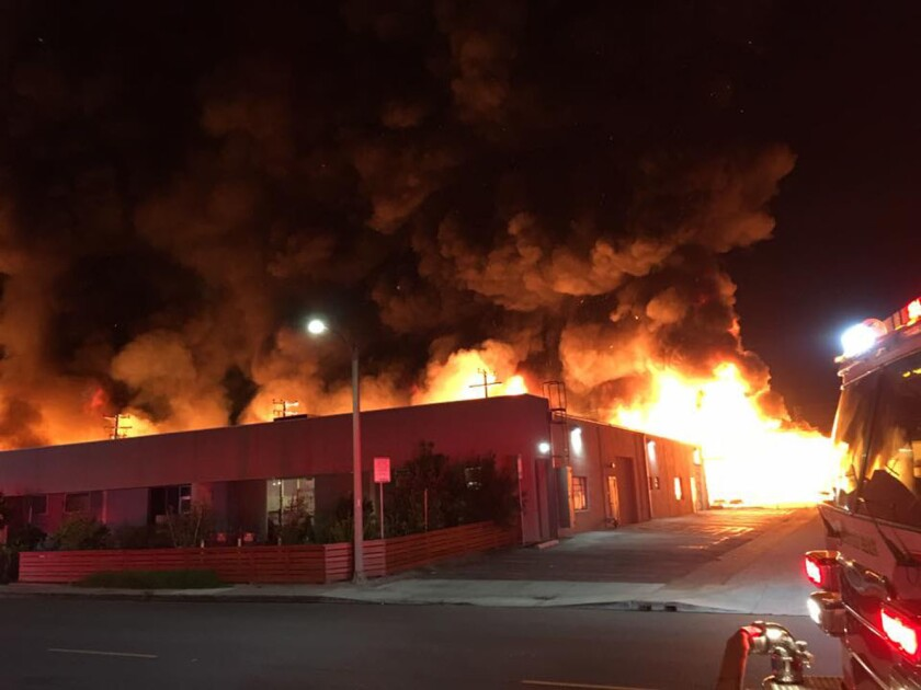Flames consume a storage area in the 800 block of Production Place in Newport Beach on Nov. 11.