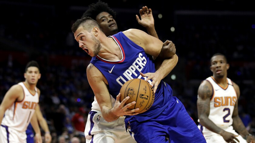 Clippers' Danilo Gallinari is fouled by Phoenix Suns' Josh Jackson during a game Oct. 21 in Los Angeles.