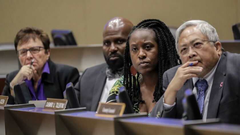 Sheriff Civilian Oversight Commission Chair Patricia Giggans, left, executive director Brian Williams, Vice Chair Priscilla Ocen and commissioner Casimiro Tolentino at a meeting of the panel on Thursday.