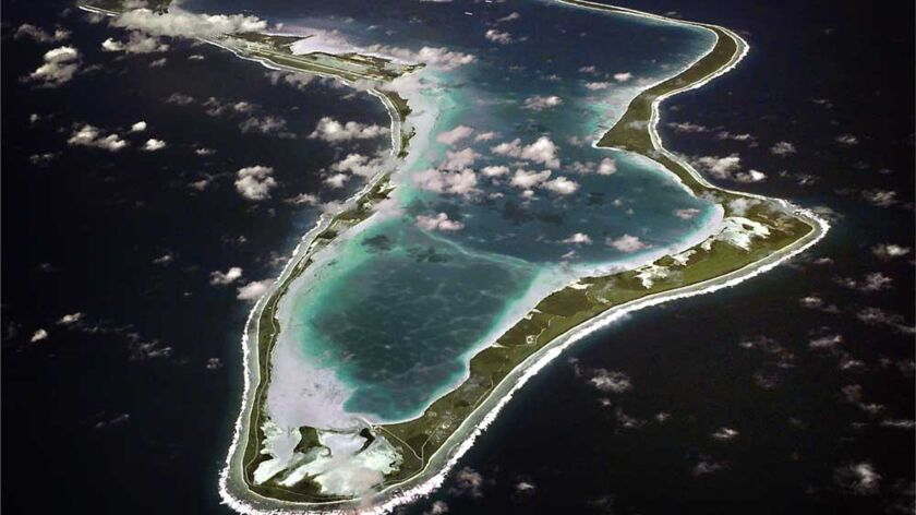 An aerial view of Diego Garcia, site of a U.S. Navy base on an Indian Ocean archipelago where inhabitants were forcibly expelled in the 1960s and 1970s.