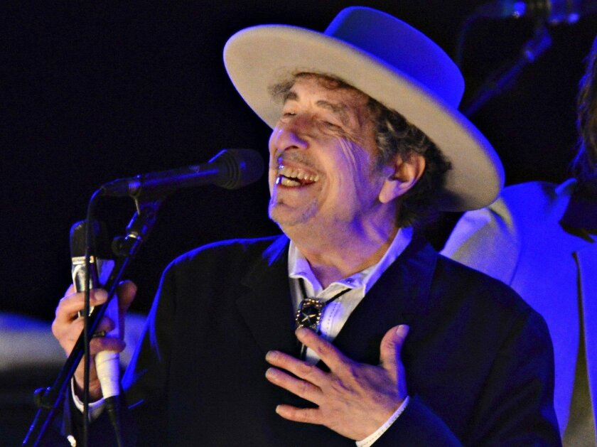 Bob Dylan is shown performing at a music festival in May.