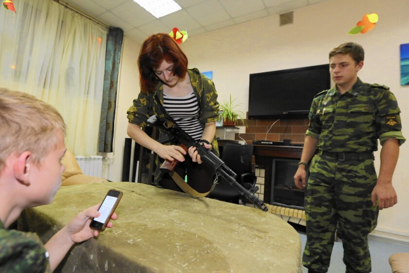 Margarita Maluchenkova, 18, disassembles an AK-74 assault rifle as part of a drill at the Our Army club in Moscow.