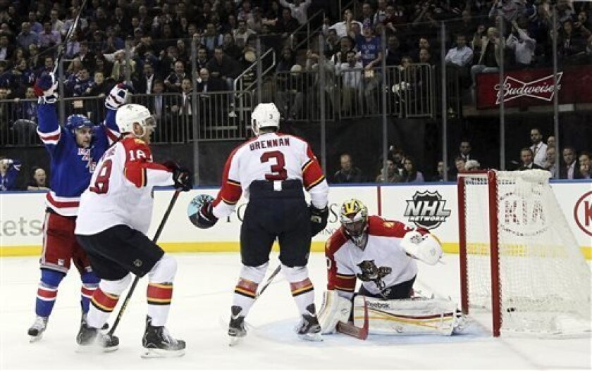 New York Rangers' Mats Zuccarello, left, of Norway, reacts after scoring a goal against the Florida Panthers during the second period of an NHL hockey game, Thursday, April 18, 2013, at Madison Square Garden in New York. (AP Photo/Mary Altaffer)