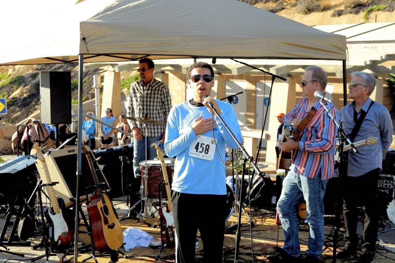 A Solana Beach local sings the National Anthem at the Solana Beach 5K