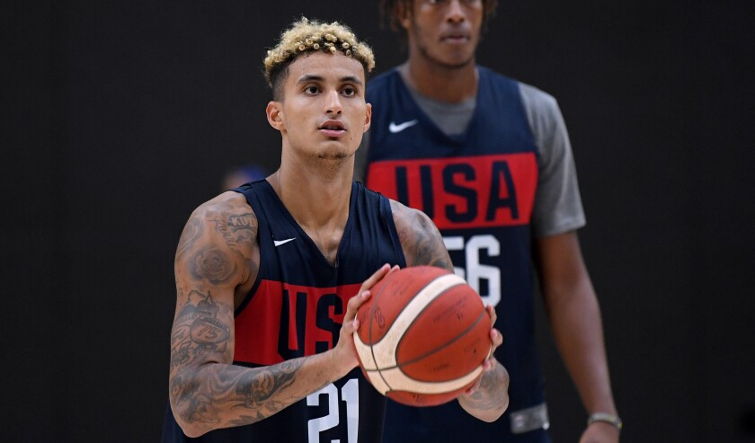 Team USA's Kyle Kuzma (21) shoots jumpers in front of Myles Turner (56) during World Cup training camp at UCLA Health Training Center on Tuesday in El Segundo.