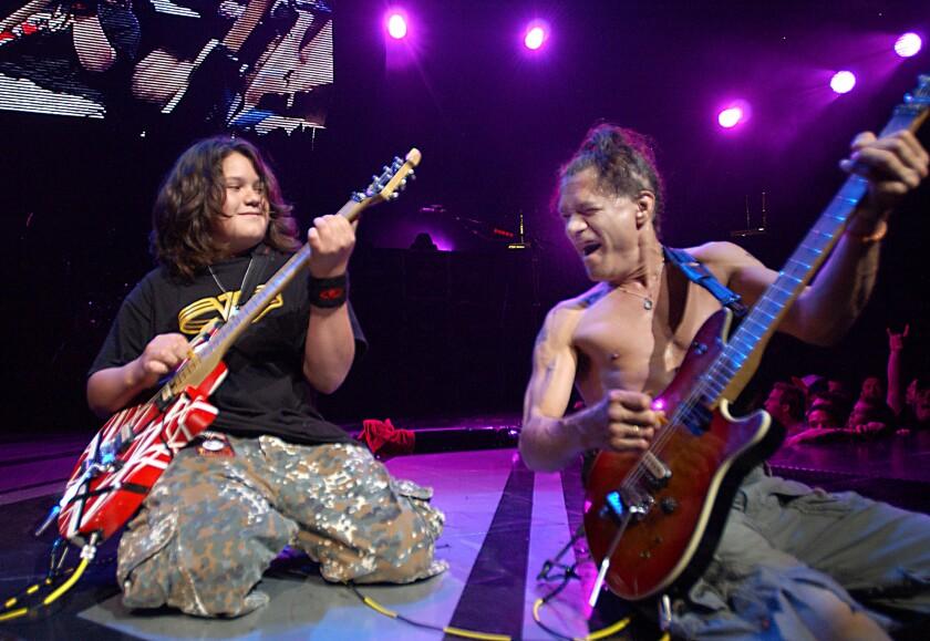 Van Halen's Wolfgang Van Halen and Eddie Van Halen perform in 2004.