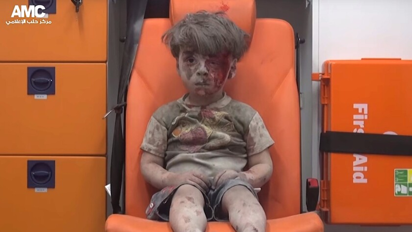 A video made available by the Aleppo Media Center activist group shows Omran Daqneesh sitting in an ambulance after his home was destroyed in an airstrike in Syria on Aug. 17, 2016.