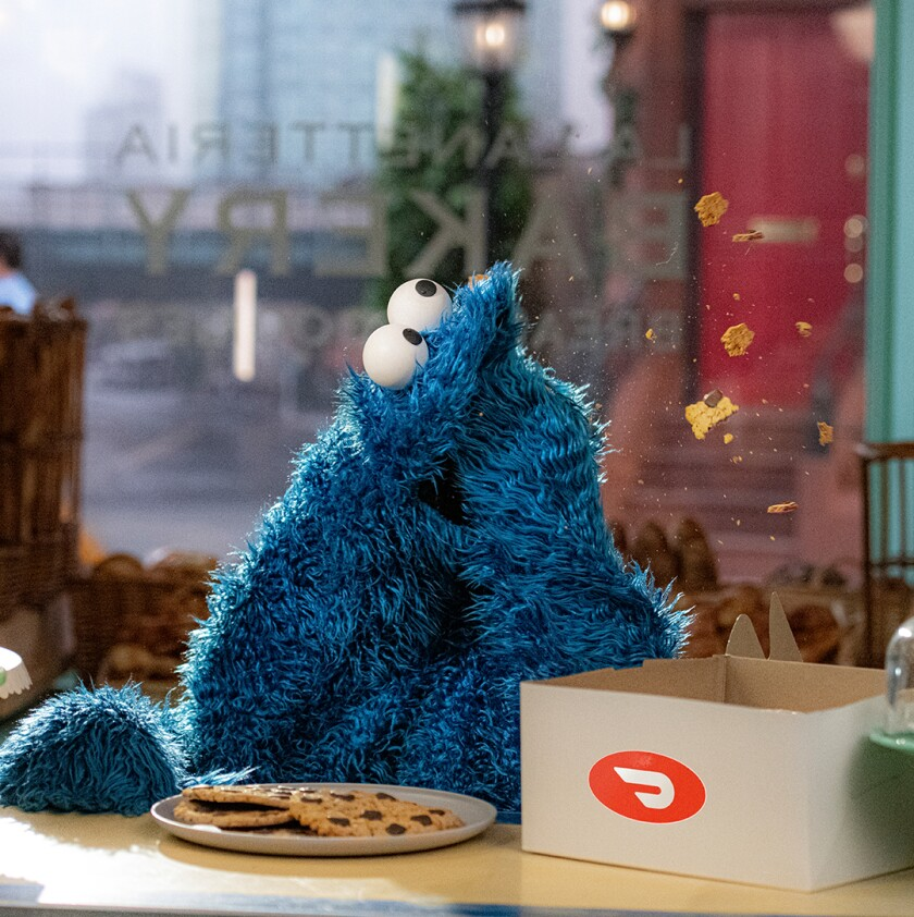 Cookie Monster eating cookies from a box