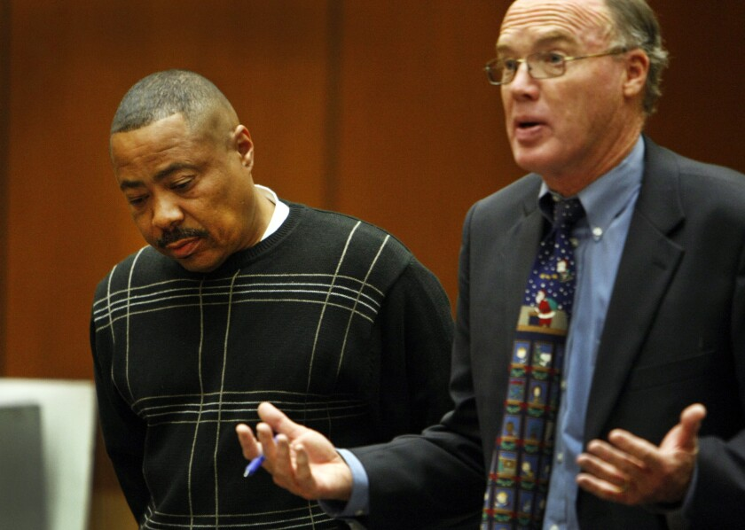 Former Los Angeles County Sheriff's Deputy Michael Anthony Grundy, left, pleaded no contest to DUI and leaving the scene of an accident. His attorney is Mark S. Rafferty