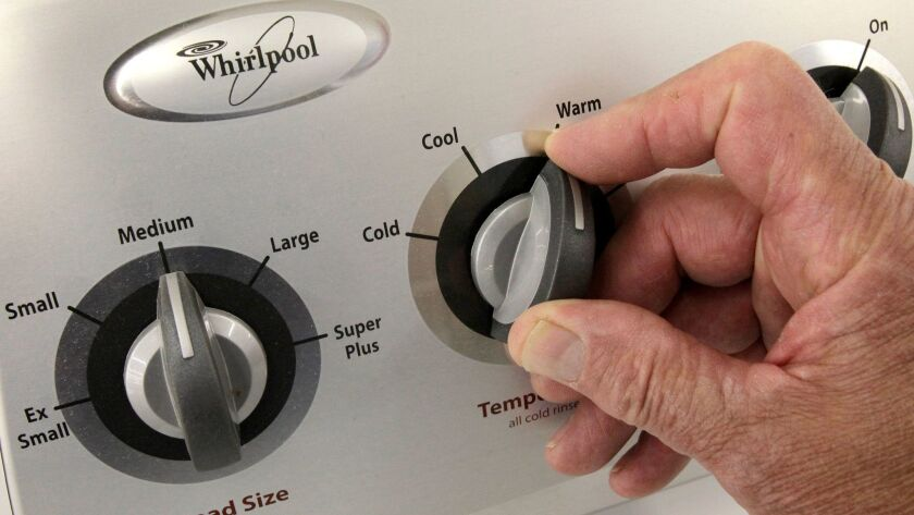 FILE - In this July 20, 2009 file photo, an unidentified employee shows off the dials on a Whirlpool