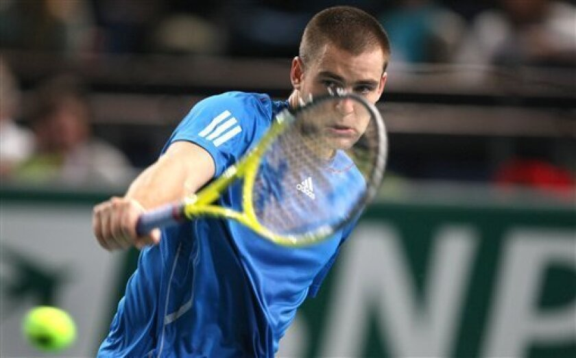 Mikhail Youzhny of Russia returns the ball to Ernests Gulbis of Latvia during their match of the Paris Tennis Masters tournament, Tuesday, Nov. 9, 2010. (AP Photo/Lionel Cironneau)