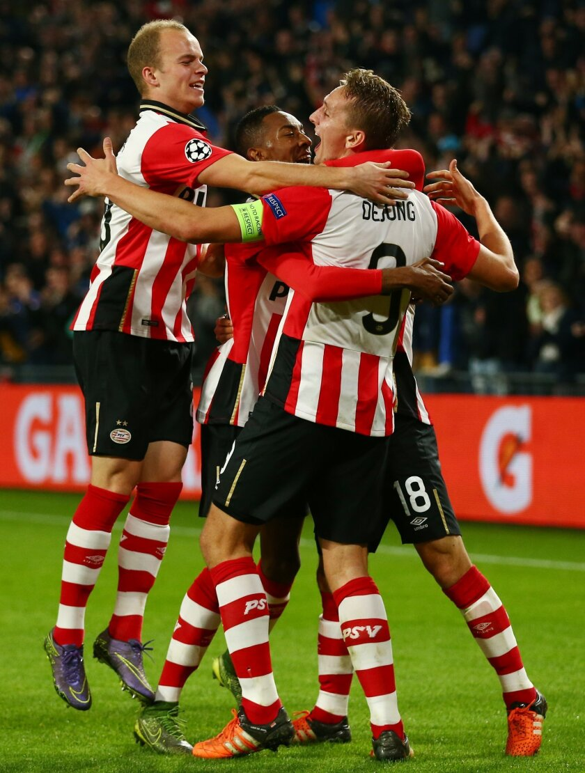 PSV's Luuk de Jong, right, celebrates his side's second goal during the Champions League Group B soccer match between PSV and VfL Wolfsburg at Philips stadium in Eindhoven, Netherlands, Tuesday, Nov. 3, 2015. (AP Photo/Peter Dejong)