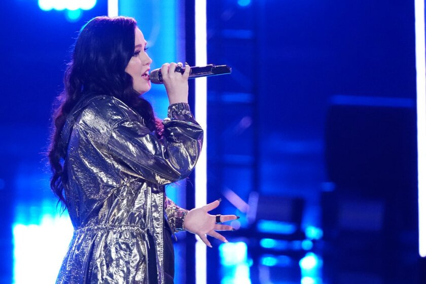"Kendra Checketts performed in the ""Live Cross Battles"" of ""The Voice"" reality competition, pitting members of different teams against one another on this season of ""The Voice"" on NBC. She is one of 24 remaining competitors who will be narrowed to 13 on April 30."