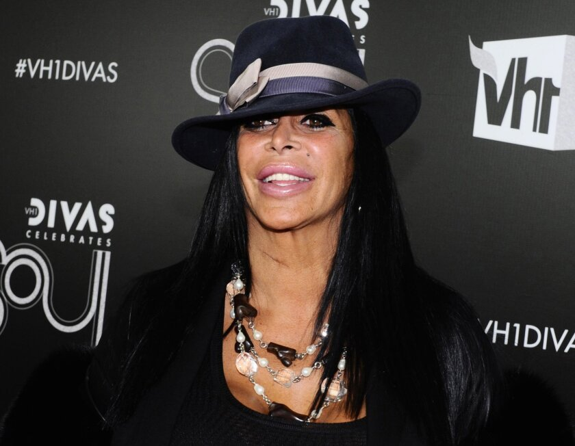 """FILE - In this Dec. 18, 2011, file photo, Angela Raiola, better known as Big Ang, arrives at """"Vh1 Divas Celebrates Soul"""" in New York. Raiola from the reality TV series """"Mob Wives"""" has died following a nearly yearlong battle with cancer, series producer Jennifer Graziano said Thursday, Feb. 18, 2016"""