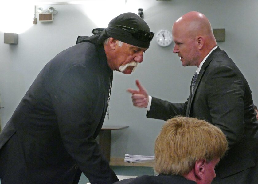 Hulk Hogan, left, whose real name is Terry Bollea, talks with attorney Shane Vogt as he appears in court Wednesday, May 25, 2016, in St. Petersburg, Fla. A Florida judge on Wednesday denied Gawker's motion for a new trial in Hogan's sex-video case and won't reduce a $140 million jury verdict. (Scot