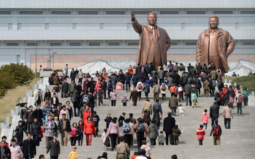North Korea marks founder's birthday with flowers, not missiles
