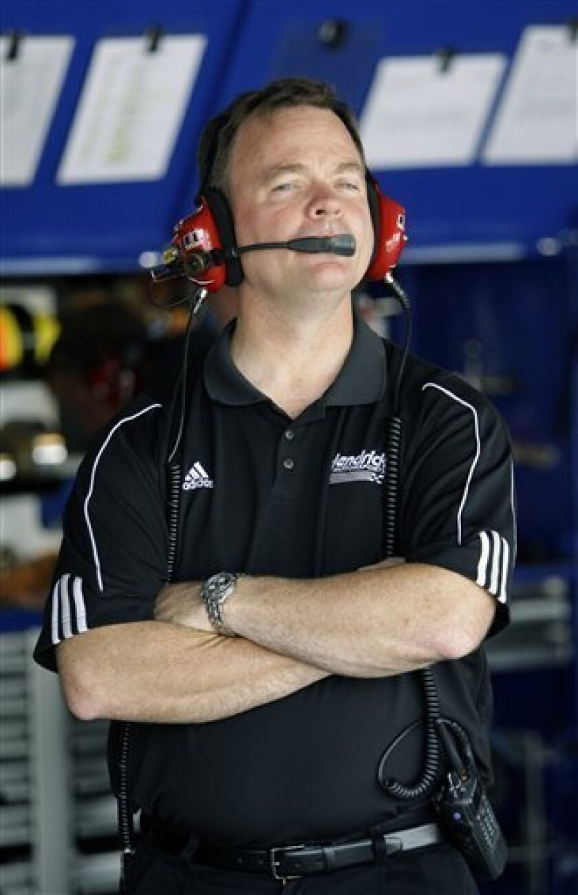Dale Earnhardt Jr.'s interim crew chief Lance McGrew watches from the garage area during practice for the NASCAR Autism Speaks 400 auto race, Saturday, May 30, 2009, in Dover, Del. (AP Photo/Rob Carr)