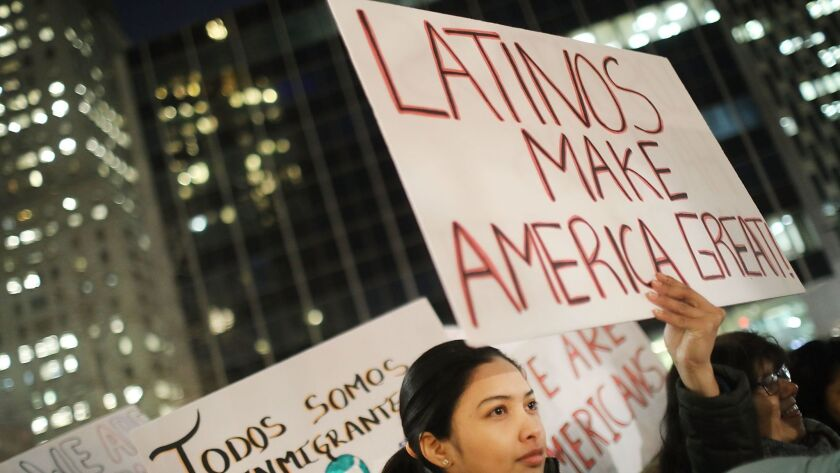 """A Valentines Day rally organized by the New York Immigration Coalition called """"Love Fights Back"""" on February 14 in New York."""