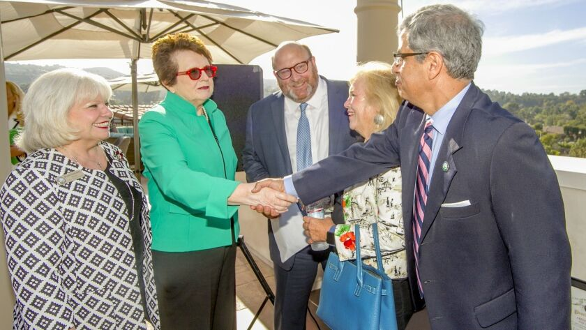 Tennis star and Atria Well-Being Coach Billie Jean King shakes hands with Laguna Niguel City Councilman Fred Minager. At left is Laguna Niguel Mayor Elaine Gennaney, Atria CEO John Moore and Candace Burroughs, staff member for state Sen. Pat Bates (R-Laguna Niguel).