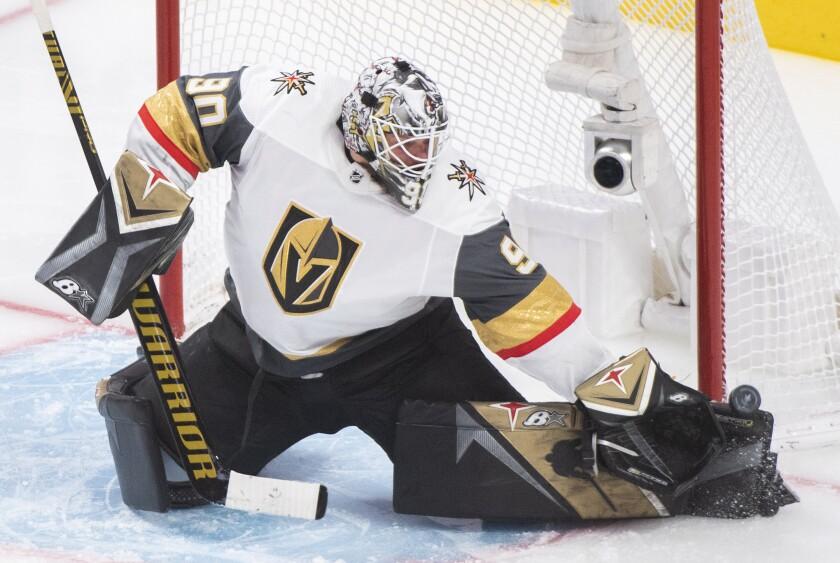 Vegas Golden Knights goaltender Robin Lehner makes a save against the Montreal Canadiens during the third period of Game 4 in an NHL Stanley Cup playoff hockey semifinal in Montreal, Sunday, June 20, 2021. (Graham Hughes/The Canadian Press via AP)
