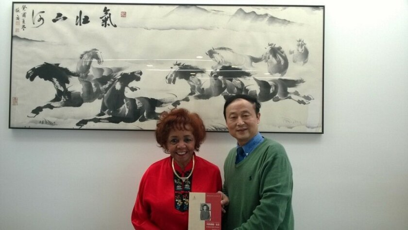 Dr. Marvalene Hughes and Dr. Hong Dai with the biographical book written in her honor, titled 'World Women University President: Dr. Marvalene Hughes.' Courtesy photo