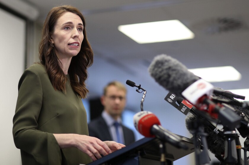 New Zealand Prime Minister Jacinda Ardern addresses a press conference on the latest COVID-19 updates in Auckland, New Zealand, Monday, Sept. 21, 2020. All remaining virus restrictions will be lifted across much of New Zealand from late Monday, with the exception of the largest city, Auckland, which will continue to have some restrictions for at least another 16 days. (Greg Bowker/NZ Herald via AP)