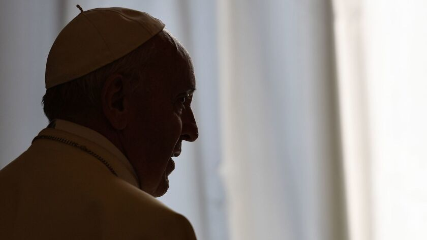 Pope Francis attends a meeting at the Vatican on Friday.