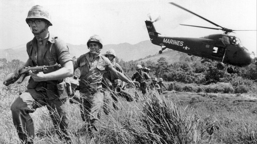 U.S. Marine infantry stream into a suspected Viet Cong village near Da Nang in Vietnam during the Vietnamese war on April 28, 1965.
