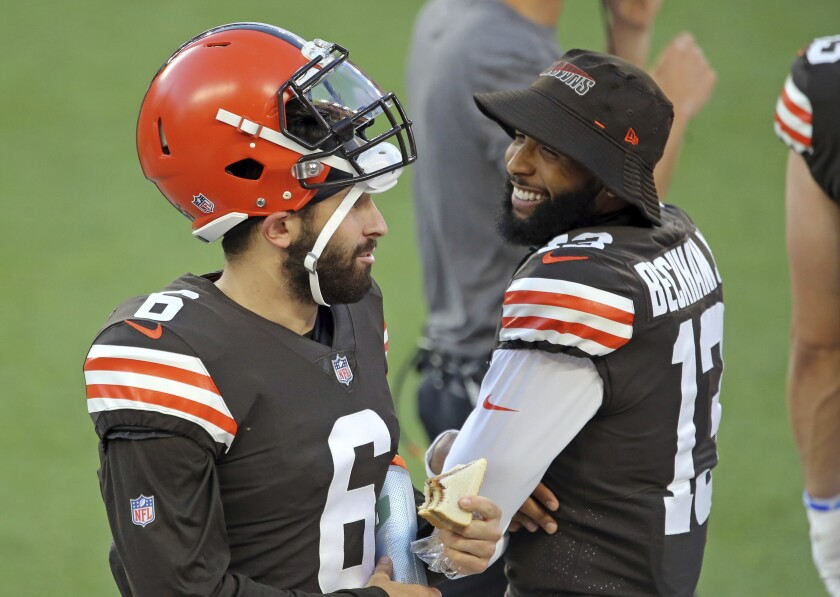 Cleveland Browns quarterback Baker Mayfield and wide receiver Odell Beckham Jr. talk during an NFL football scrimmage at FirstEnergy Stadium in Cleveland, Friday, Sept. 4, 2020. (Joshua Gunter/Cleveland.com via AP)