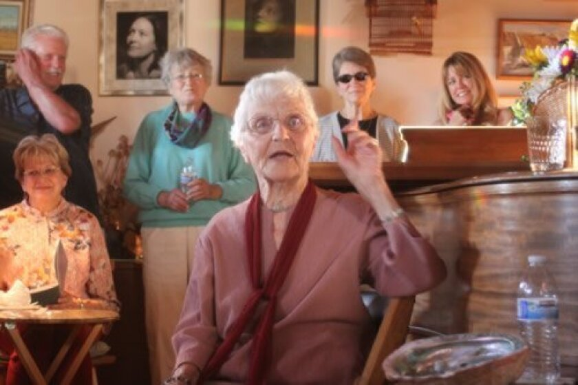Surrounded by friends and family, Dorothy Haven tells stories at her La Jolla home during ehr 100th birthday party.